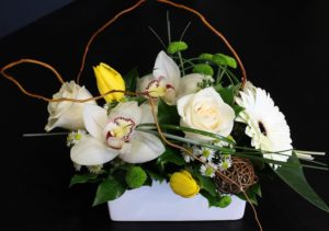 Modern flowers with white jar