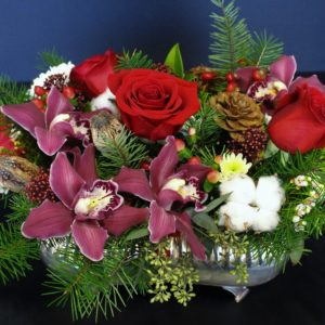 Rose red flowers with pine cones