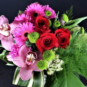 Close up for basket of red and pink flowers