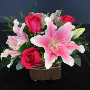 Basket of red and pink flowers